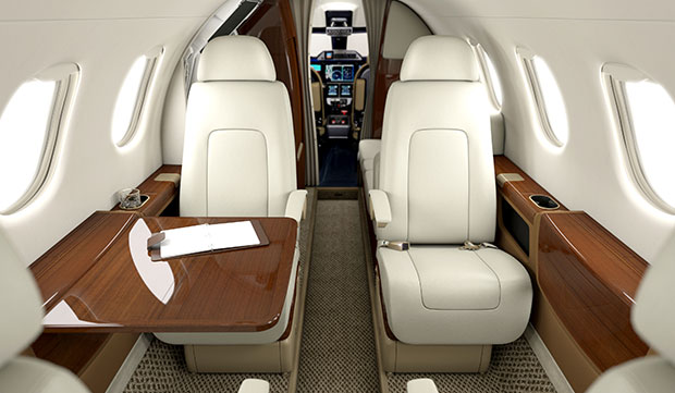 Phenom 300 interior business jet charter