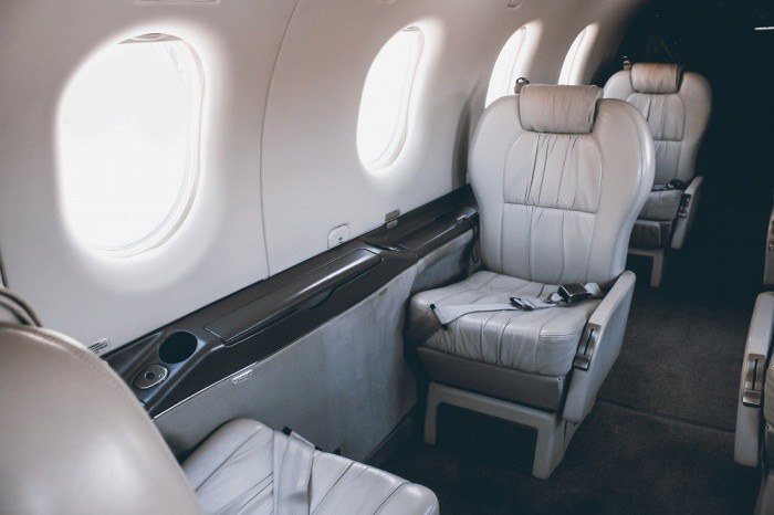 First Class vs. Private Jets